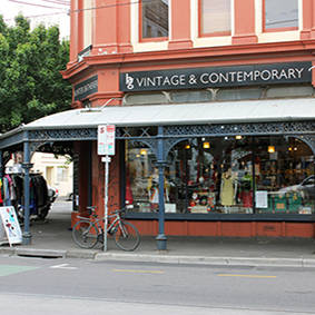 Image of the outside of the Fitzroy shop in Brunswick Street with vintage and contemporary signage prominent on orange building