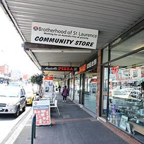 Street view image from Glenhuntly road showing shop window and entrance